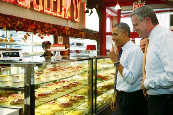 President Barack Obama and New York City Democratic Mayoral Candidate Bill de Blasio visits Junior's Cheesecake restaurant in the Brooklyn borough of New York, Friday, Oct. 25, 2013. (AP Photo/Charles Dharapak)